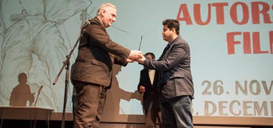 "Director Tamhane receiving \""Aleksandar Sasa Petrovic\"" Award"
