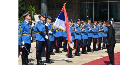 Ambassador bowing to the Serbian Flag