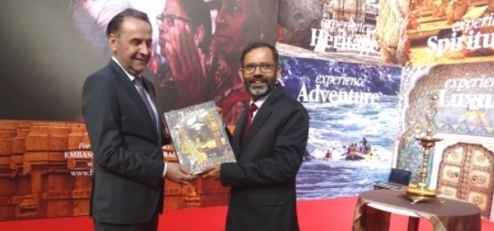 Ambassador presenting a book on Indian Tourism to Minister Ljajic